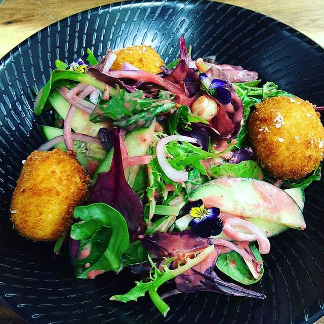Crumbed goats cheese salad woth radish, local mixed leaves, roasted hazelnuts, red onion, cucumber and strawberry vinaigrette