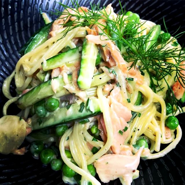 Smoked salmon spaghetti with zucchini, peas, touch of cream and Parmesan