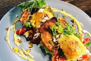 Hot Shott's Sweetcorn fritters with smashed avocado and eggs